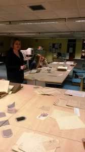 Archivist Chloe Phillips shows volunteers letters written back from the Front a century ago