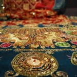 Detail from a gharcholu, one of the traditional saris on display