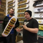 Winning artist Max Whetter (left) with Tom Hudson of Roots Skate Shop, Camborne in Cornwall