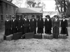 Land Army women arriving for work with their suitcases