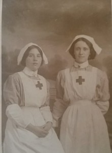 Lillie Uren (left) in nurse's uniform