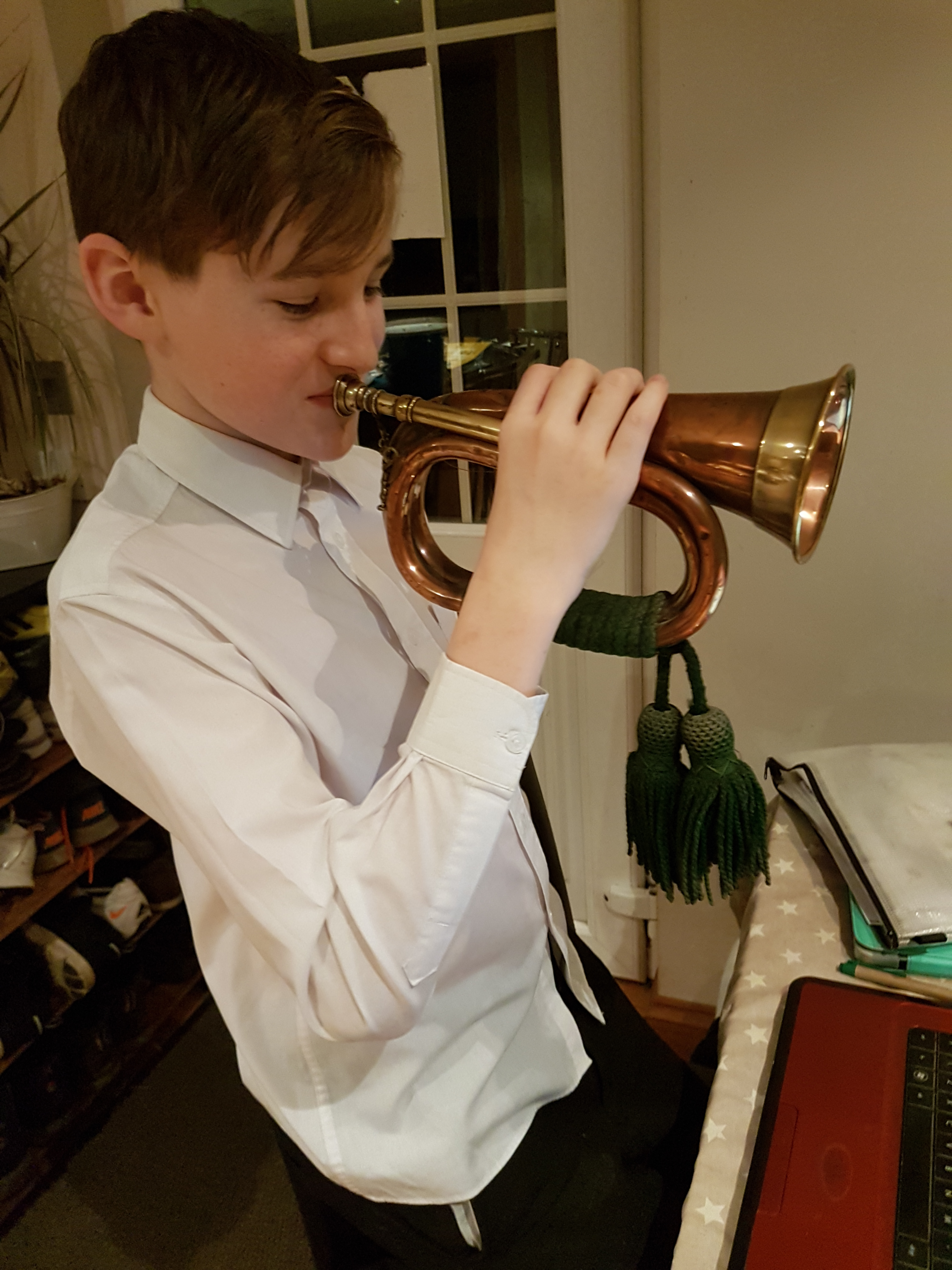 Corey playing bugle